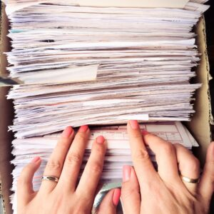 hands searching through documents